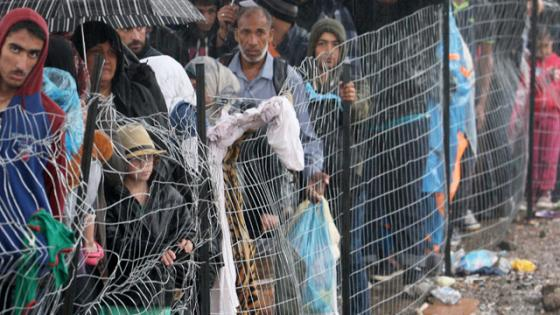 Refugees behind a fence