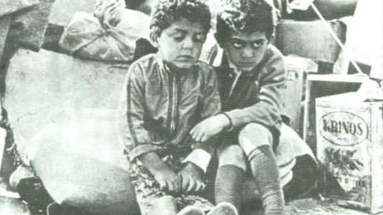 Little boys in war zone